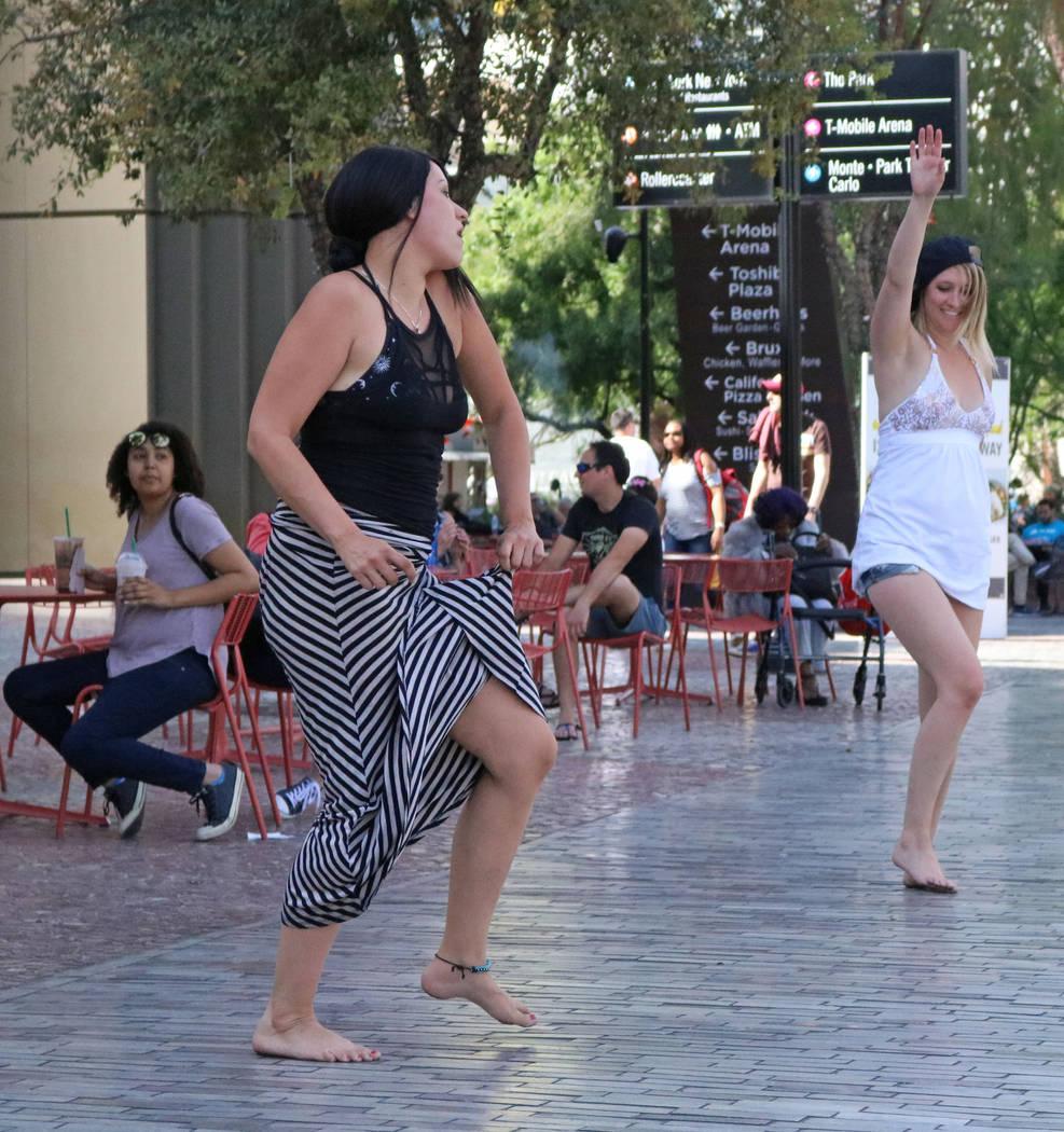 Kimberly Davis, left, and Larissa Fischer, tourists from Denver, dance to live music at New York, New York hotel-casino, Wednesday, April 5, 2017 in Las Vegas. (Gabriella Benavidez Las Vegas Revie ...