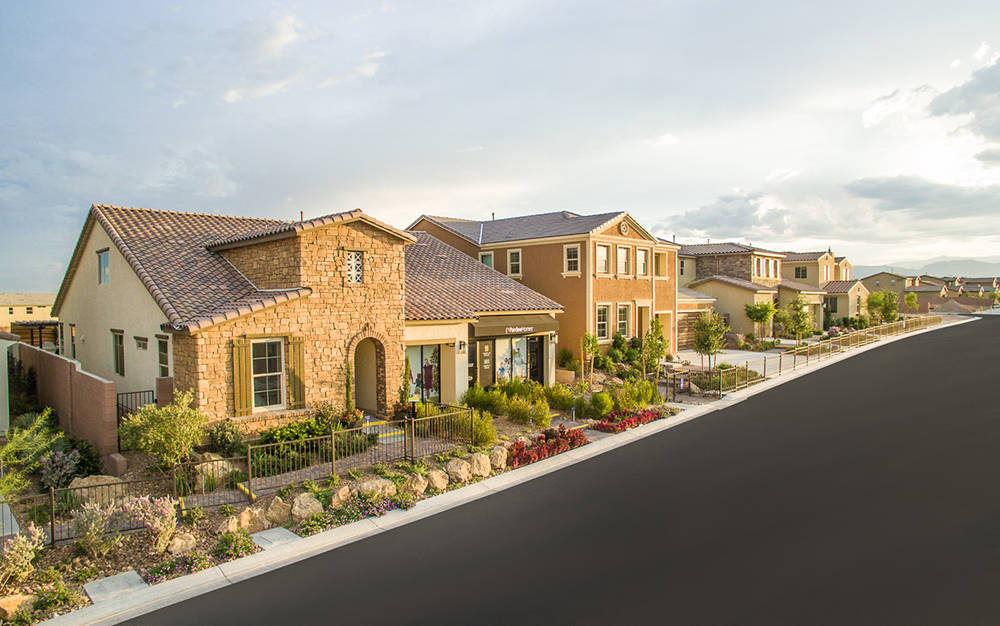 Nine floor plans are offered at Pardee Homes' gated neighborhoods of Castle Rock and North Peak in the Eldorado master-planned community. Shown is a street scene of the Castle Rock model homes.  ...