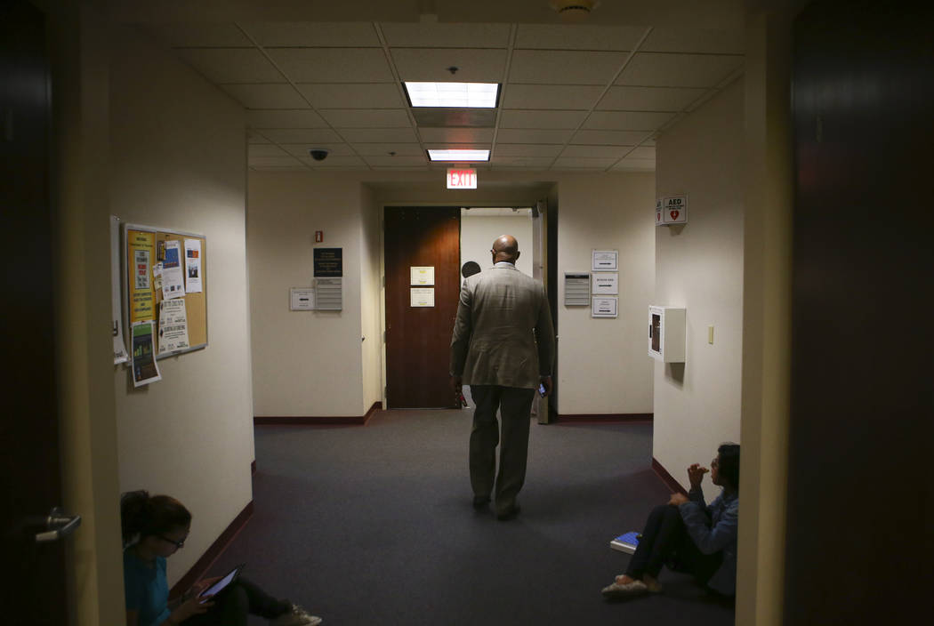 A man walks to a room for an Assembly education committee meeting discussing topics including the Achievement School District and sex education at the Sawyer Building in Las Vegas on Wednesday, Ap ...