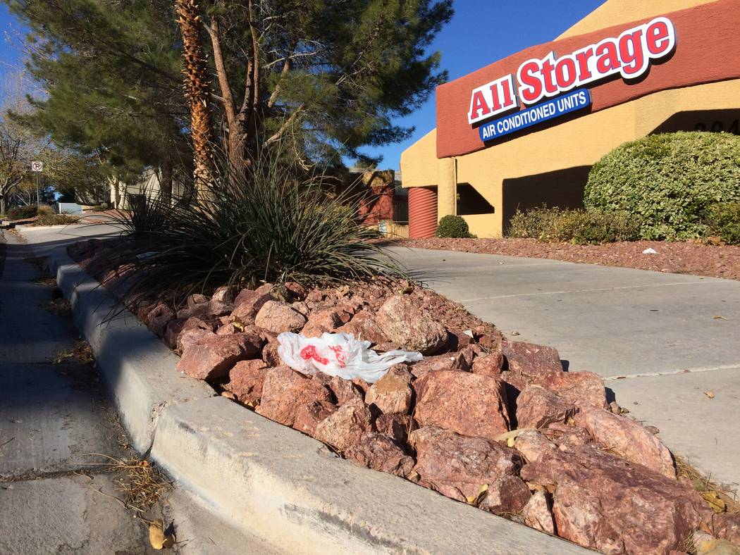 A plastic bag is seen caught in the decorative rock before a business in The Lakes in January 2017. The Legislature is set to consider a bill that will ban them in retail stores. (Jan Hogan/View)