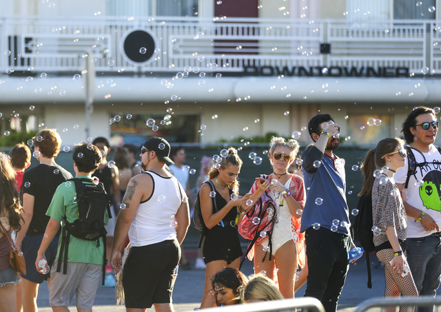 Attendees watch as bubble pass by during the Life is Beautiful music and arts festival in downtown Las Vegas on Sunday, Sept. 25, 2016. Chase Stevens/Las Vegas Review-Journal Follow @csstevensphoto