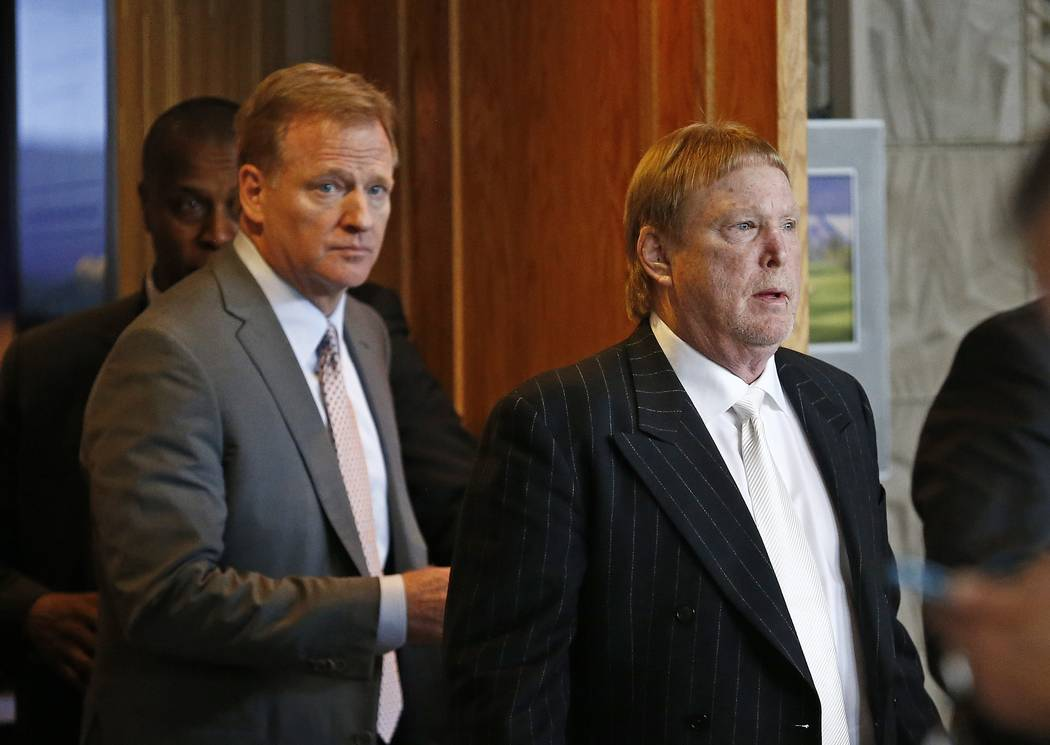 Oakland Raiders owner Mark Davis, right, emerges from the NFL football annual meetings with NFL Commissioner Roger Goodell, left, after owners approved the move of the Raiders to Las Vegas, Monday ...