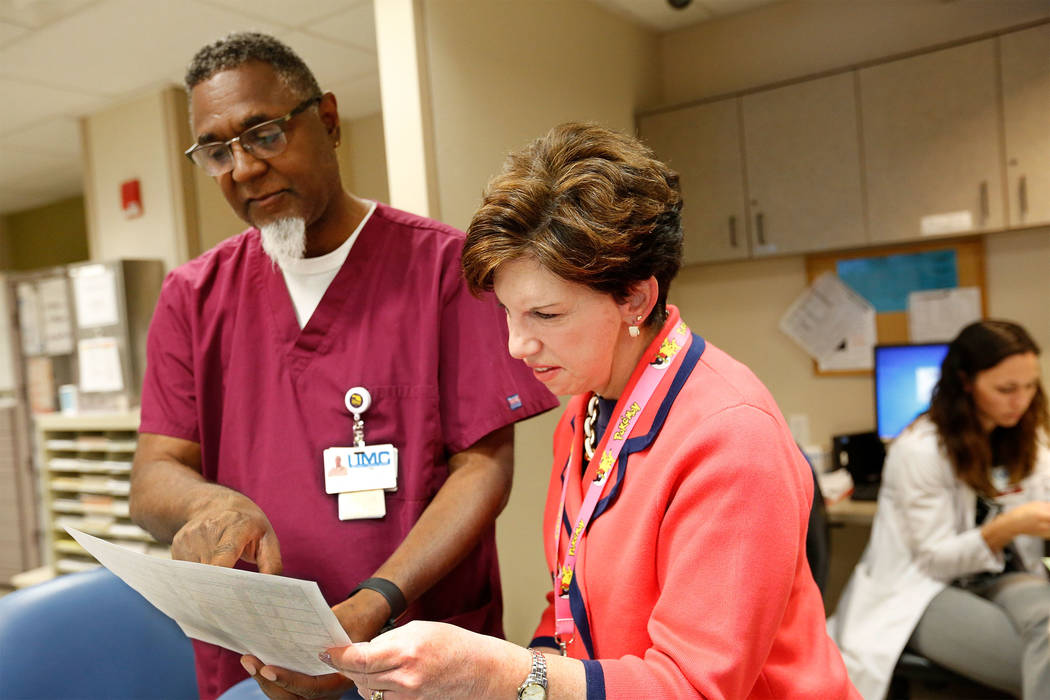 University Medical Center Chief Nursing Officer Debra Fox speaks to registered nurse Michael Collins at UMC in Las Vegas, Thursday, April 6, 2017. Chitose Suzuki Las Vegas Review-Journal @chitosephoto