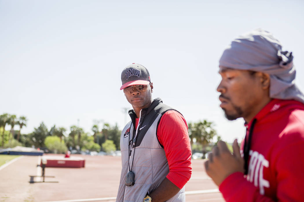 UNLV track and field coach Larry Wade, center, coaches boxer Shawn Porter at the UNLV track in Las Vegas Monday, April 10, 2017. Elizabeth Brumley Las Vegas Review-Journal @EliPagePhoto