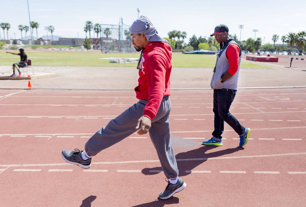 Boxer Shawn Porter, center, completes circuits during strength and conditioning training with his coach Larry Wade at the UNLV track in Las Vegas Monday, April 10, 2017. Elizabeth Brumley Las Vega ...
