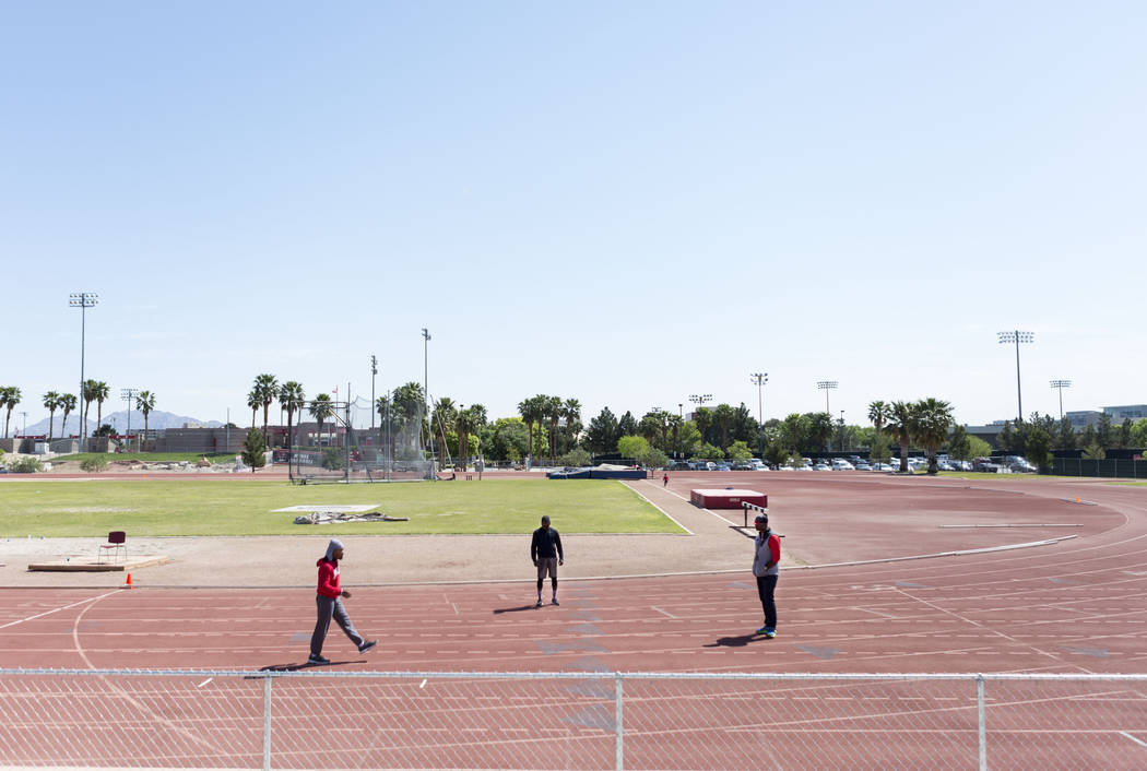 UNLV track and field coach Larry Wade, right, coaches boxer Shawn Porter, left, with help of boxer Hank Lundy, center, at the UNLV track in Las Vegas Monday, April 10, 2017. Elizabeth Brumley Las  ...