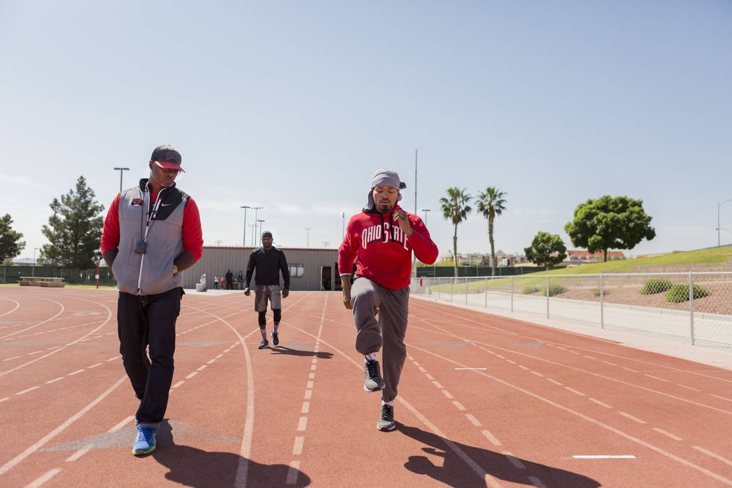 UNLV track and field coach Larry Wade, left, coaches boxer Shawn Porter at the UNLV track in Las Vegas Monday, April 10, 2017. Elizabeth Brumley Las Vegas Review-Journal @EliPagePhoto