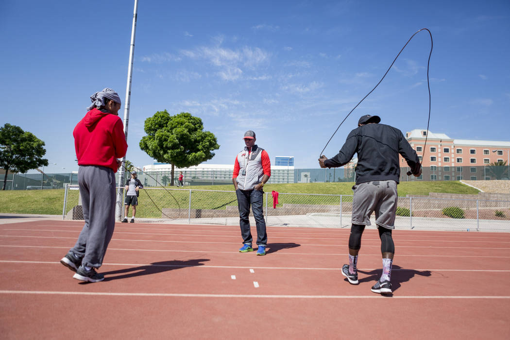 UNLV track and field coach Larry Wade, center, coaches boxer Shawn Porter, left, with help of boxer Hank Lundy at the UNLV track in Las Vegas Monday, April 10, 2017. Elizabeth Brumley Las Vegas Re ...