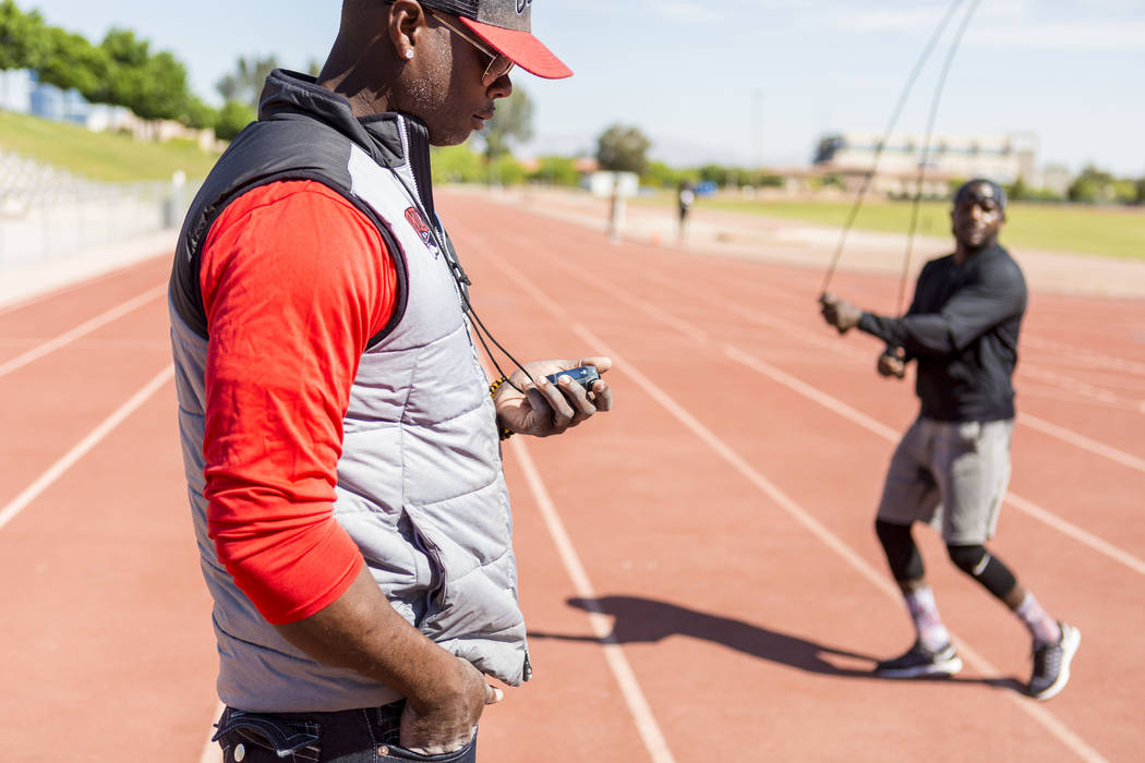 UNLV track and field coach Larry Wade coaches boxer Shawn Porter at the UNLV track in Las Vegas Monday, April 10, 2017. Elizabeth Brumley Las Vegas Review-Journal @EliPagePhoto