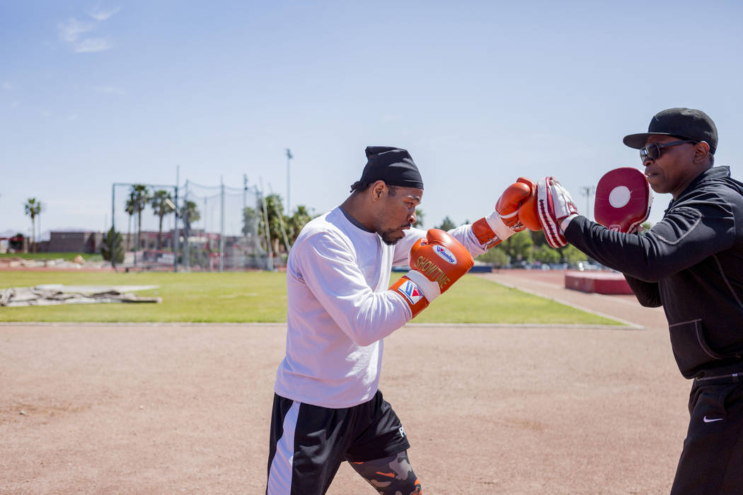Boxer Shawn Porter trains with his father and trainer Kenny Porter at the UNLV track in Las Vegas Monday, April 10, 2017. Elizabeth Brumley Las Vegas Review-Journal @EliPagePhoto