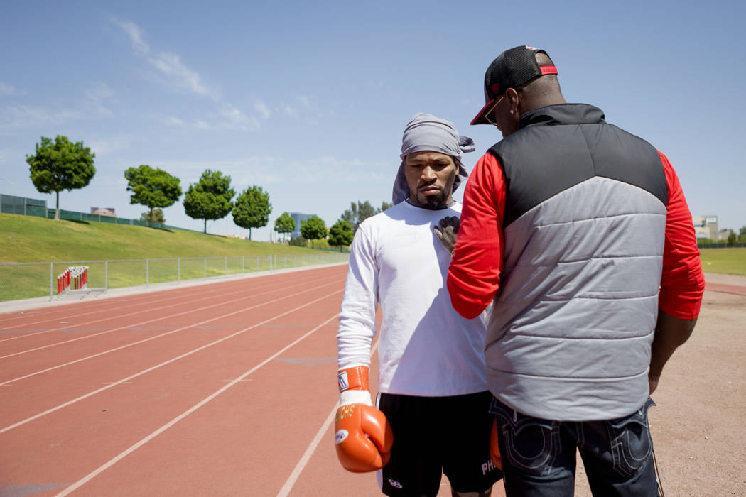 Boxer Shawn Porter, left, listens to his strength and conditioning coach Larry Wade at the UNLV track in Las Vegas Monday, April 10, 2017. Elizabeth Brumley Las Vegas Review-Journal @EliPagePhoto