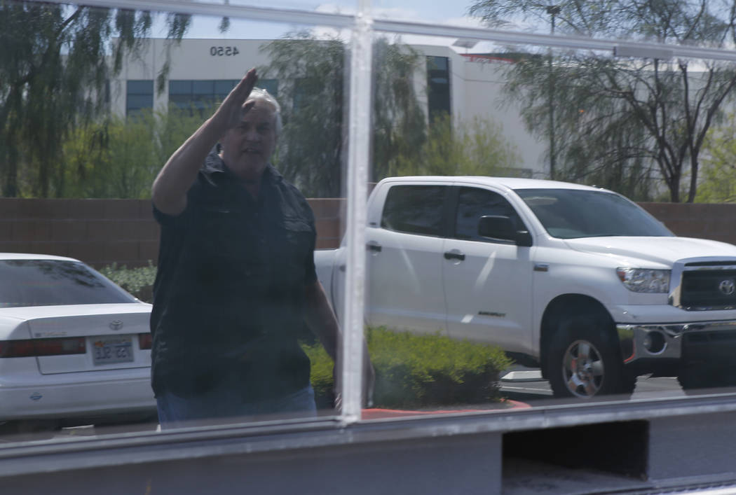 Thomas Gleason, 70, is seen in the reflection of his solar panel wall on Thursday, April 6, 2017, in North Las Vegas. Gleason says he submitted a bid to build President Donald Trump's proposed bor ...