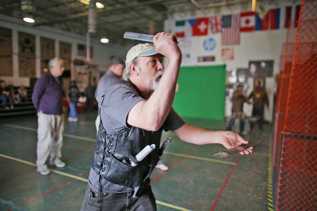 Bill Lagrosso practices speed throwing knives at the U.S. Nationals Pro/Am Knife & Tomahawk Championships on Sunday, April 9, 2017, at the Superhero Foundry in Las Vegas. The event is a fundra ...
