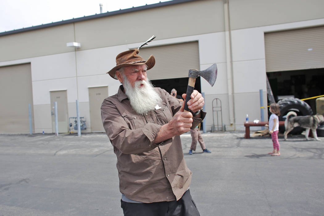 Michael Pearl practices throwing a tomahawk at the U.S. Nationals Pro/Am Knife & Tomahawk Championships on Sunday, April 9, 2017, at the Superhero Foundry in Las Vegas. The event is a fundrais ...