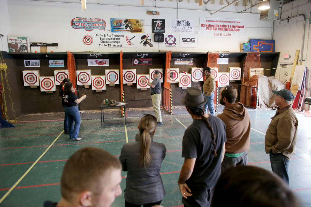 An audience watches Chris Miller throw knives at the U.S. Nationals Pro/Am Knife & Tomahawk Championships  on Sunday, April 9, 2017, at the Superhero Foundry in Las Vegas. The event is a fundr ...