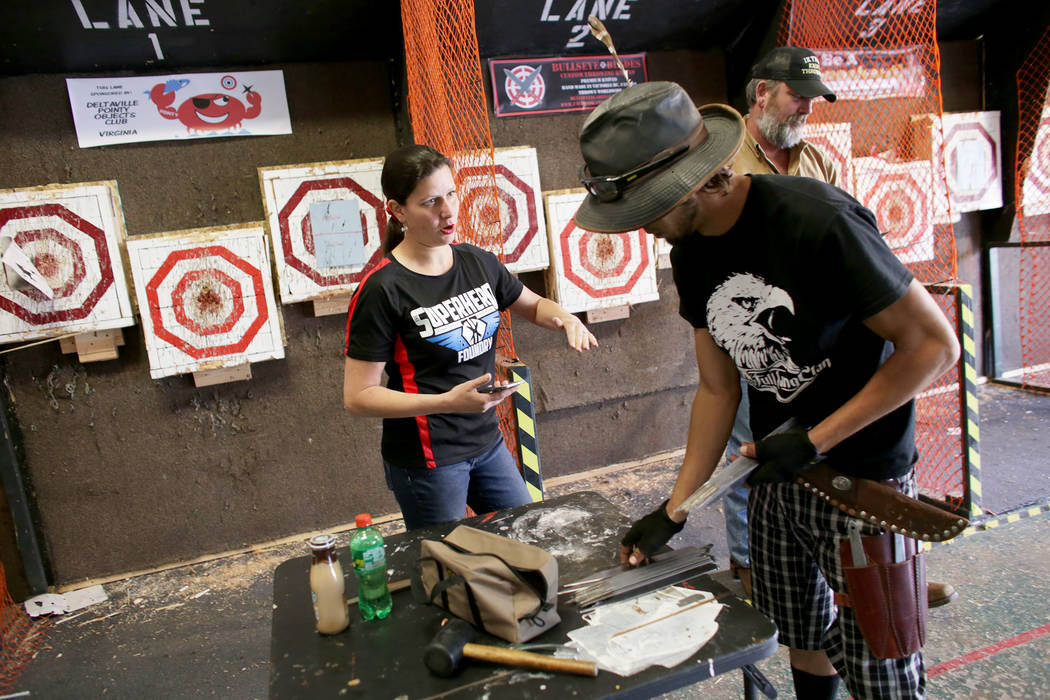 Melody Cuenca talks to Judah Myers before he competes at the U.S. Nationals Pro/Am Knife & Tomahawk Championships on Sunday, April 9, 2017, at the Superhero Foundry in Las Vegas. The event is  ...