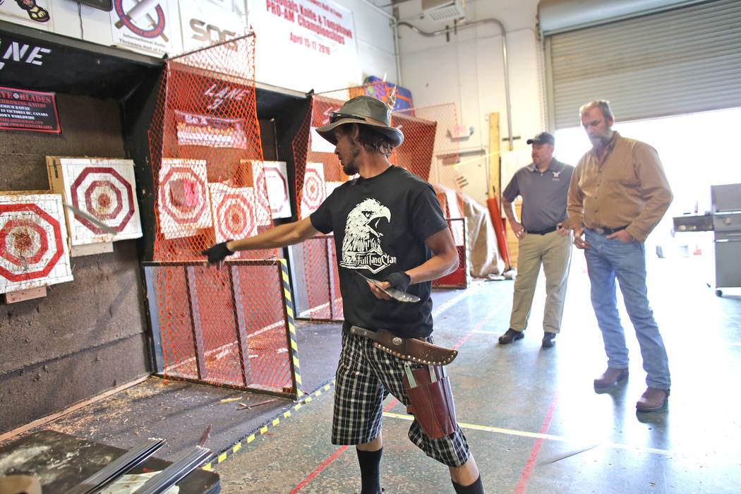 Judah Myers throws knives at targets at the U.S. Nationals Pro/Am Knife & Tomahawk Championships on Sunday, April 9, 2017, at the Superhero Foundry in Las Vegas. The event is a fundraiser for  ...