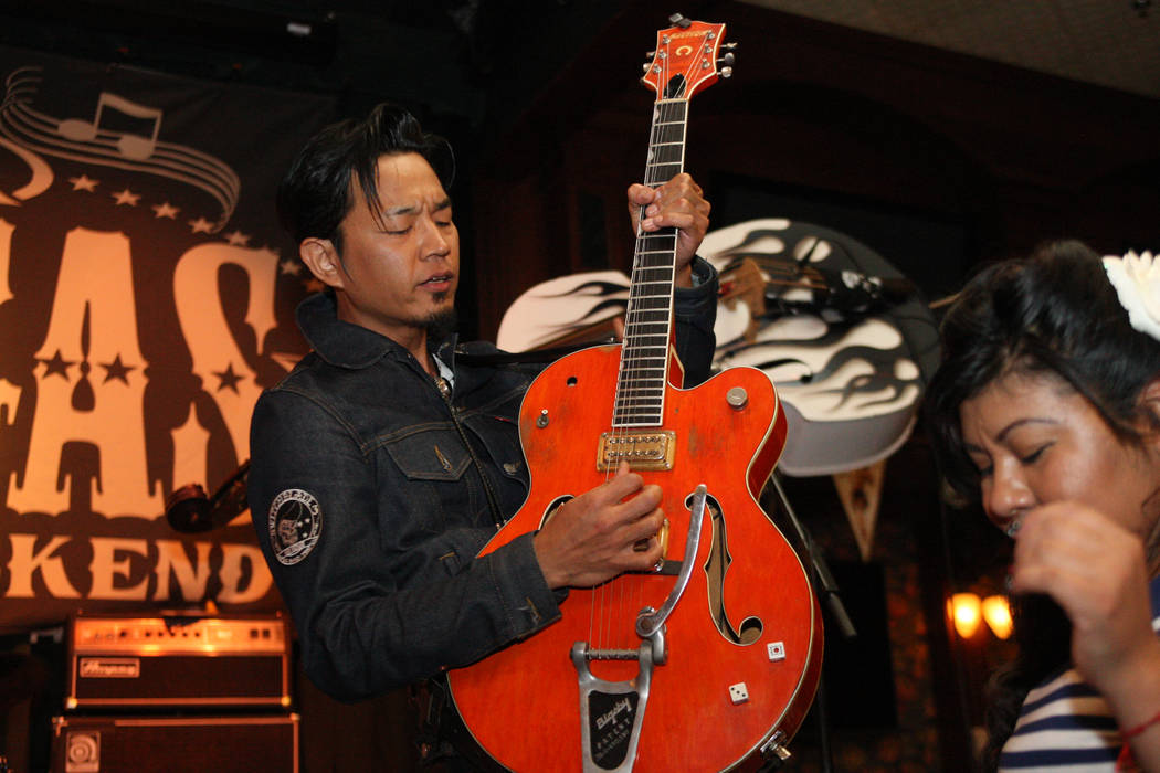 Eitaro Sako, from North Hollywood, Calif., rips out some lightning fast licks while jamming with The Buzzards in Brendan's Pub at the Viva Las Vegas Rockabilly Weekend in the Orleans hotel-casino  ...