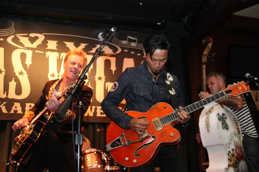 Eitaro Sako, center, from North Hollywood, Calif., rips out some lightning fast licks while jamming with The Buzzards in Brendan's Pub at the Viva Las Vegas Rockabilly Weekend in the Orleans hotel ...