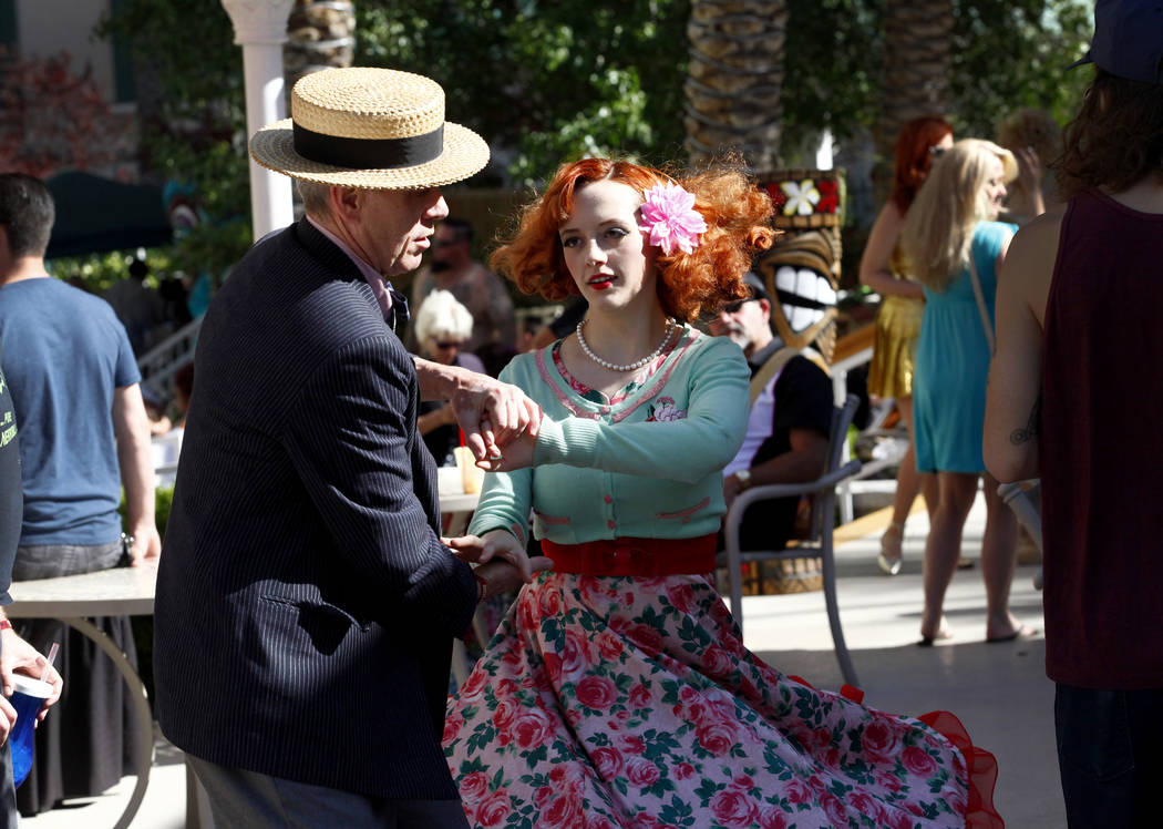 Scotty Hopkins, left, and Foxie Kitten of San Francisco, California dance to the poolside music at the 19th Annual Viva Las Vegas Rockabilly Weekender at the Orleans Hotel and Casino on Saturday,  ...