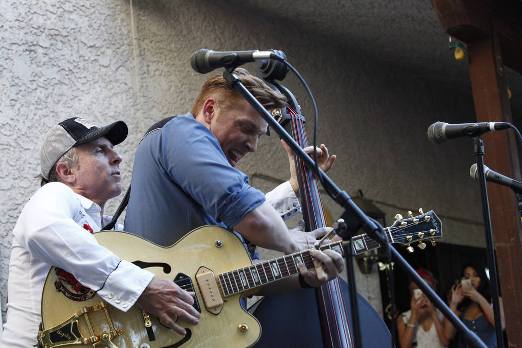 Scott Hinds, right, of the Royal Hounds swaps instruments with the guitar player at Ronny Weiser's Rockabilly Weekender Meet and Greet on Wednesday April 13, 2016. (Michael Quine/Las Vegas Review- ...