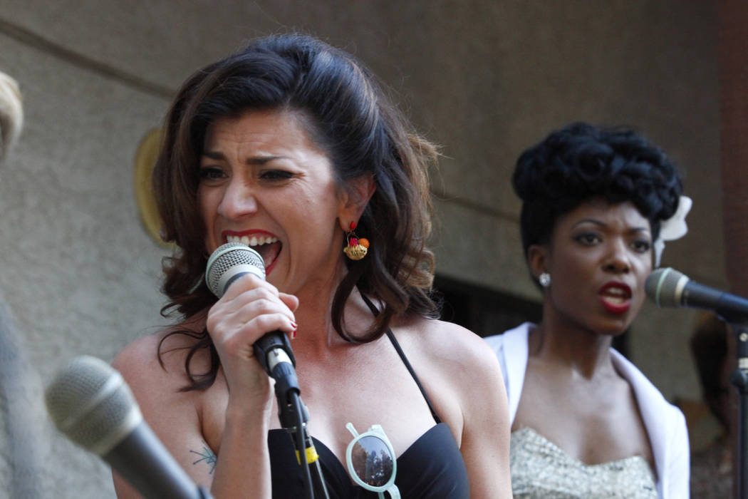 Darcy Wood, left, and Temeka Estes from Chicago join the band on stage at Ronny Weiser's Rockabilly Weekender Meet and Greet on Wednesday April 13, 2016. (Michael Quine/Las Vegas Review-Journal) F ...
