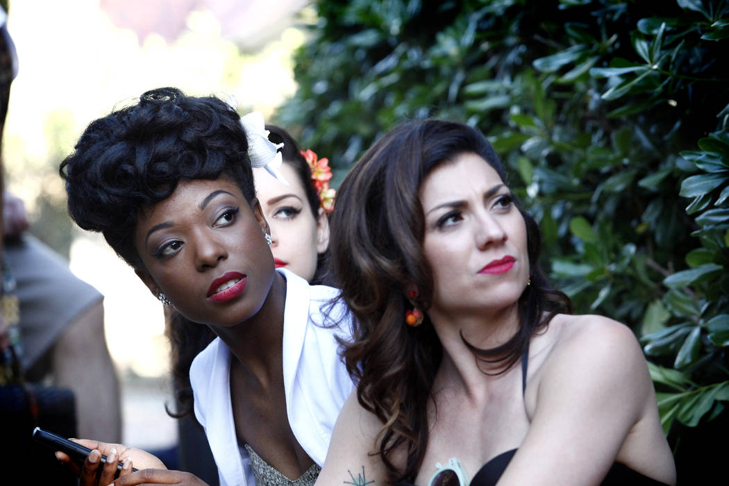Temeka Estes,left, Kelly Lipinsky, center, and Darcy Wood from Chicago listen to the entertainment at Ronny Weiser's Rockabilly Weekender Meet and Greet on Wednesday April 13, 2016. (Michael Quine ...