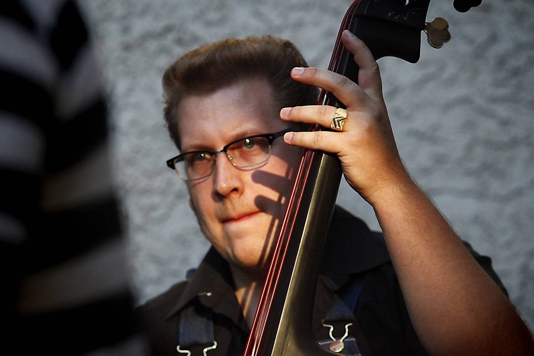 Kyle Hawkins from Oklahoma City, Oklahoma thumps an upright bass at Ronny Weiser's Rockabilly Weekender Meet and Greet on Wednesday April 13, 2016. (Michael Quine/Las Vegas Review-Journal)