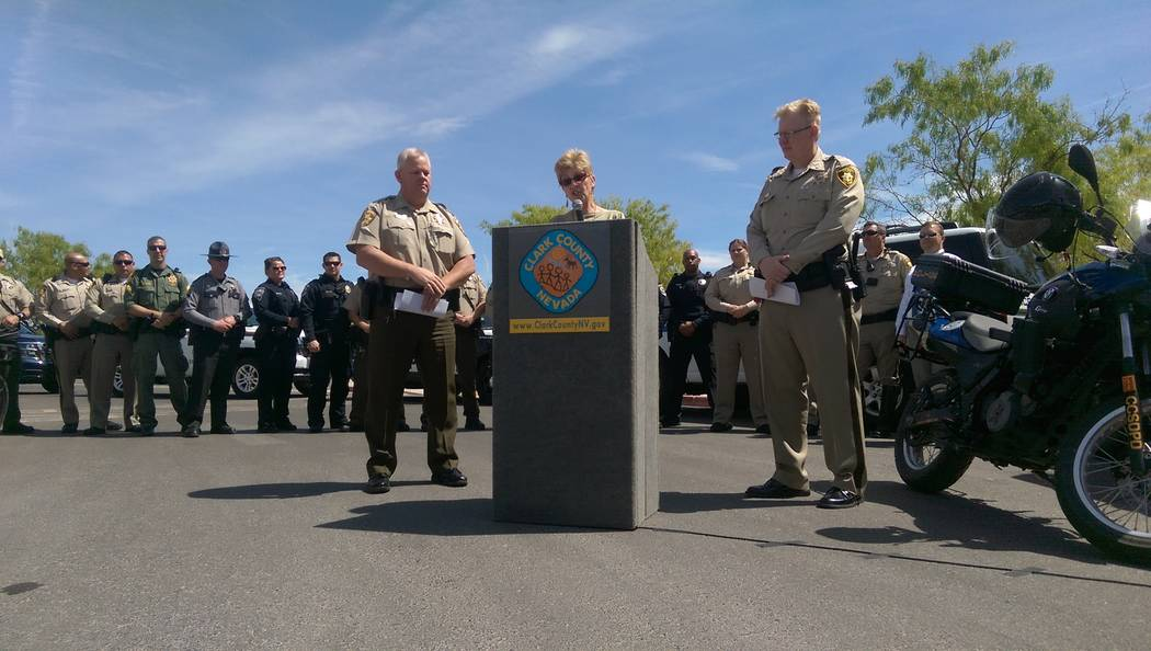 Clark County Commissioner Chris Giunchigliani speaks at a press briefing on crime at the Wetlands Park on Thursday. To her right is Clark County Park Police Commander Roy Michael; to her left is L ...