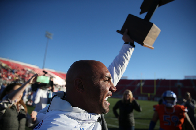 Bishop Gorman's head football coach, Kenny Sanchez, celebrates after the team's 84-8 win against Liberty in the Class 4A state football championship game at Sam Boyd Stadium on Saturday, Dec. 3, 2 ...