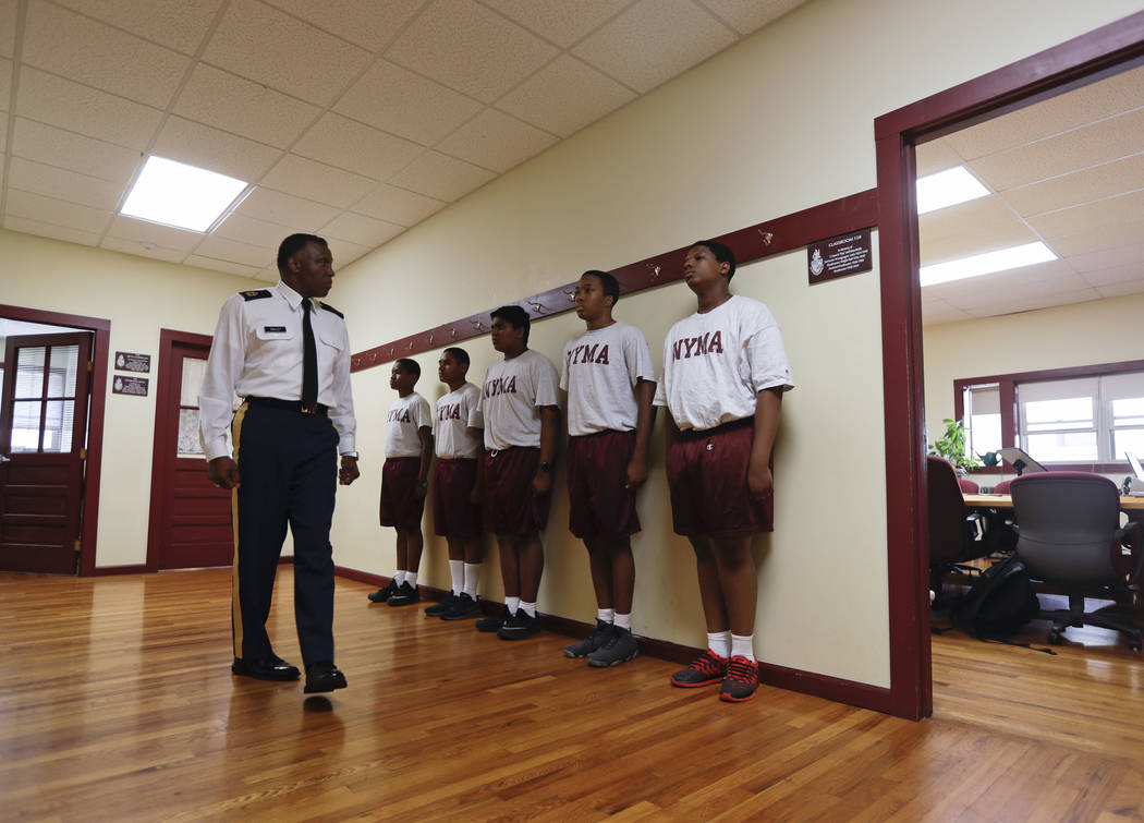 In this Thursday, Sept. 8, 2016 photo, Master Sgt. Fletcher Bailey inspects cadets before a junior ROTC class at the New York Military Academy in Cornwall-on-Hudson, N.Y. While Republican presiden ...