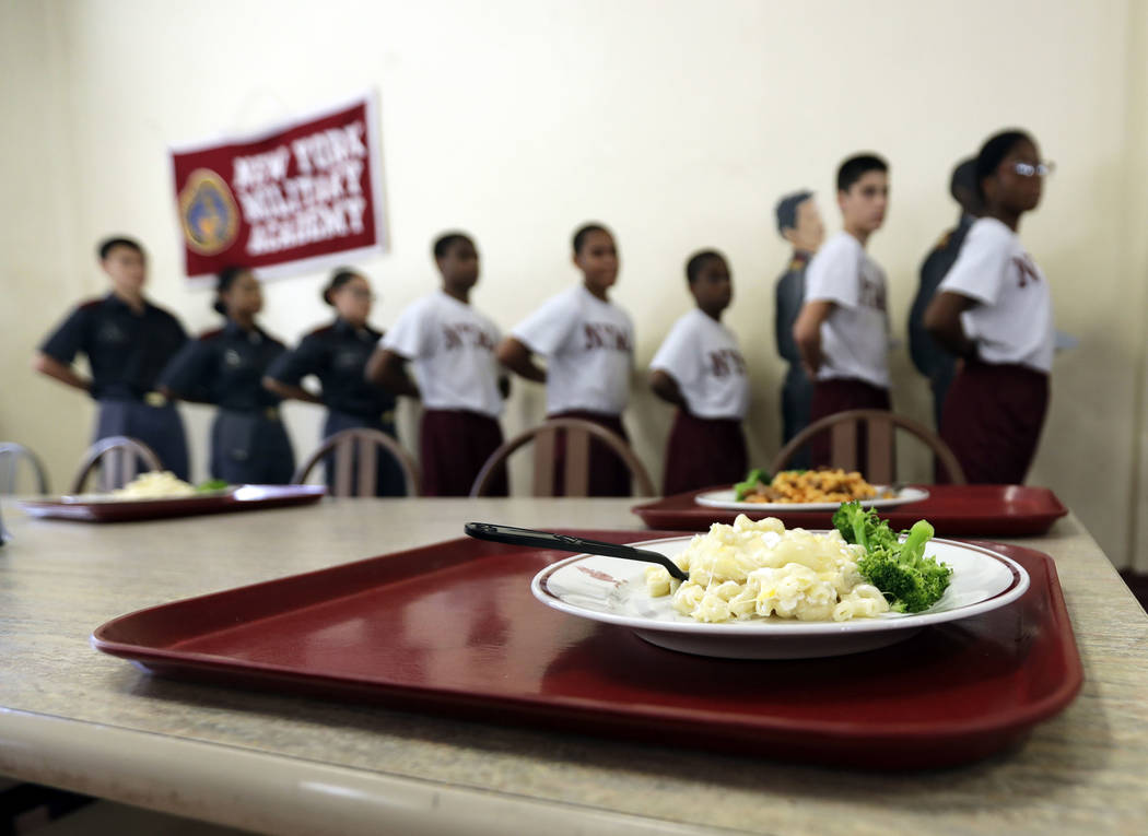 In this Thursday, Sept. 8, 2016 photo, cadets line up for lunch in the cadet mess hall at the New York Military Academy in Cornwall-on-Hudson, N.Y. While Republican presidential nominee, Donald Tr ...