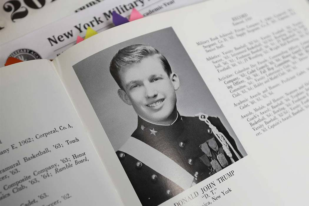 In this Thursday, Sept. 8, 2016 photo, Donald Trump is shown in the 1964 Shrapnel yearbook at the New York Military Academy in Cornwall-on-Hudson, N.Y. While Republican presidential nominee, Trump ...