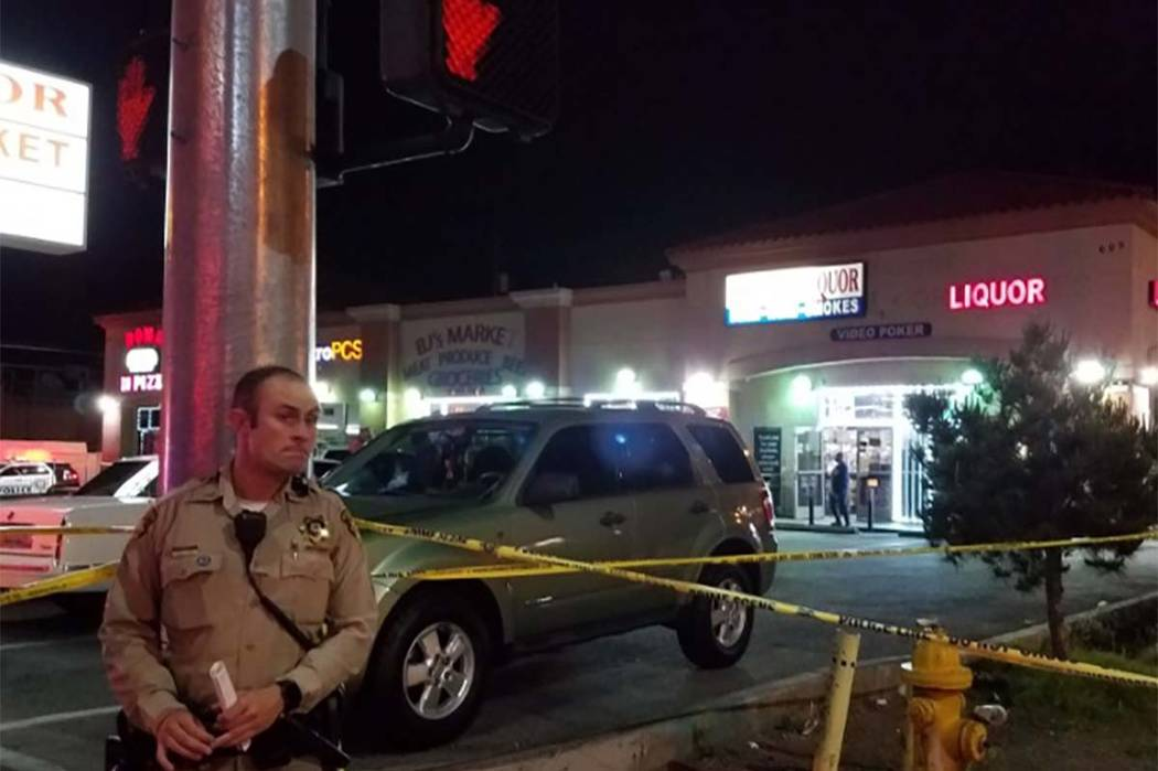 Las Vegas police are investigating the scene at 605 E. Twain Ave. after a man was shot dead in the east valley Tuesday night.  (Mike Shoro/Las Vegas Review-Journal)