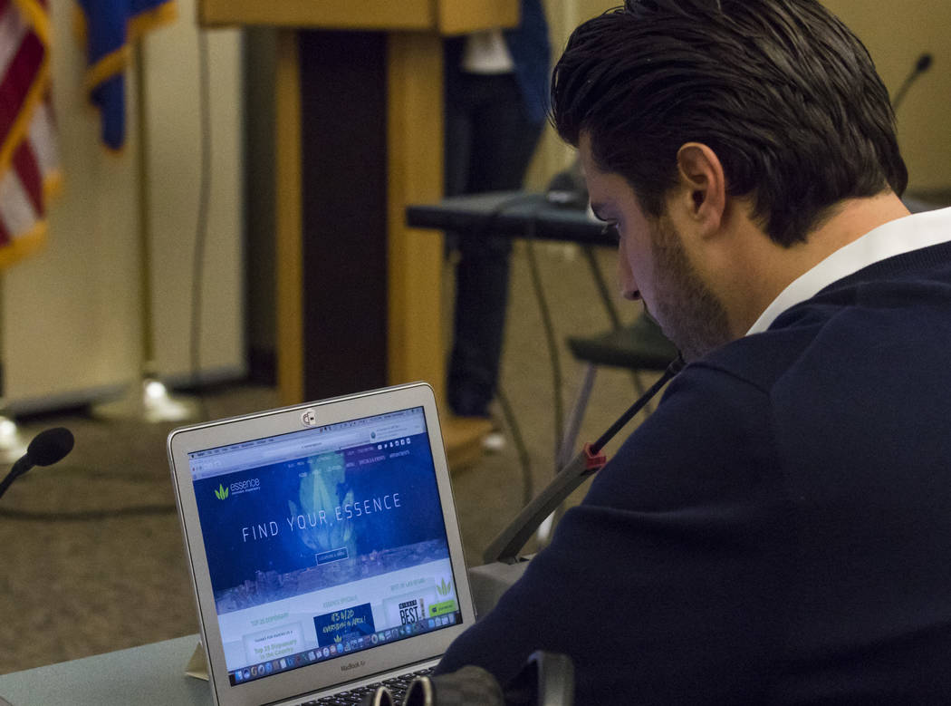 Armen Yemenidjian with Essence Cannabis dispensaries searches the Essence website during a meeting for Clark Countyճ Green Ribbon Panel at the Clark County Department of Building and Fire Pr ...