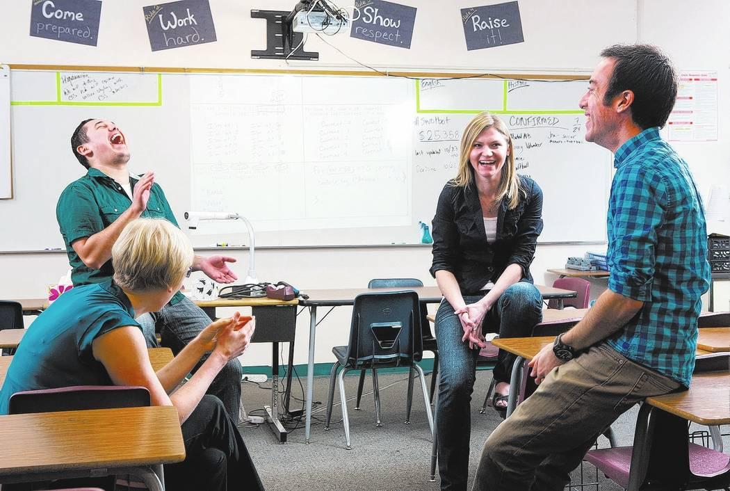 Scholars Working Overtime teachers, from left, Emily Bassier (cq), Raymond Gonzalez, Rachel Warbelow (cq) and Ben Salkowe, (cq) talk at Eldorado High School on Thursday, Oct. 24, 2013. Scholars Wo ...