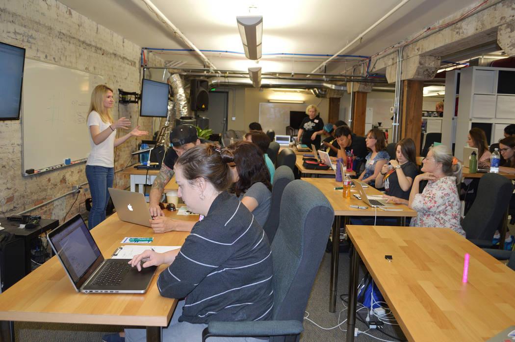 Rachel Warbelow, left, teaches a coding class in October 2014 in Denver. (Courtesy)