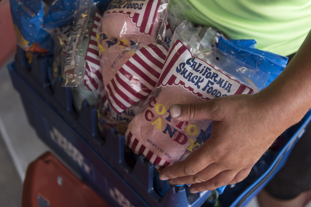 Hawker Bruce Reiner walks through the stands with more than 50 pounds of merchandise prior to a Las Vegas 51s baseball game at Cashman Field in Las Vegas Monday, June 27, 2016. Reiner has worked a ...