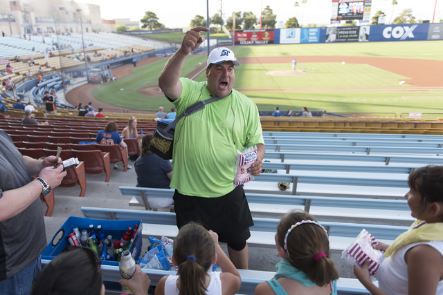 Hawker Bruce Reiner gets fans excited after selling cotton candy prior to a Las Vegas 51s baseball game at Cashman Field in Las Vegas Monday, June 27, 2016. Reiner has worked as a hawker at the fi ...
