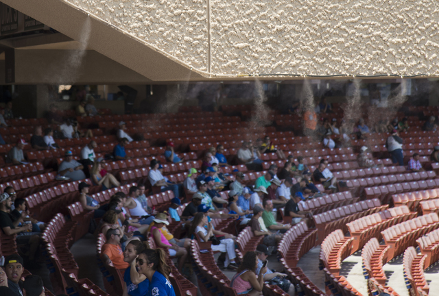 A misting system works to keep visitors cool during the Las Vegas 51s baseball game against the Tacoma Rainiers at Cashman Field on Tuesday, June 7, 2016. Temperatures during the game rose into th ...