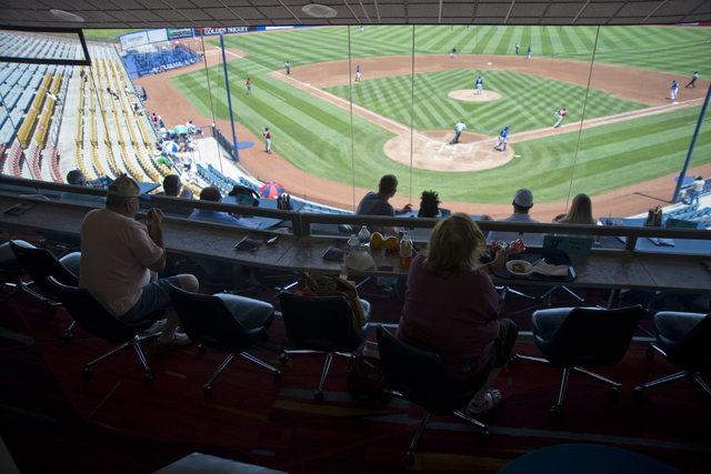 Visitors sit in an air conditioned booth during the Las Vegas 51s baseball game against the Tacoma Rainiers at Cashman Field on Tuesday, June 7, 2016. Temperatures during the game rose into the tr ...