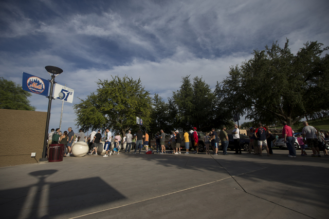 People wait in line to enter Cashman Field for the last home game of the season for the Las Vegas 51s on Saturday, Aug. 27, 2016, in Las Vegas. Erik Verduzco/Las Vegas Review-Journal Follow @Erik_ ...