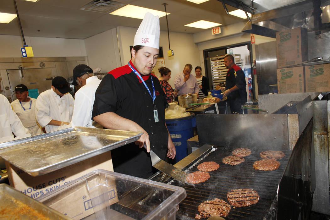 Lead Cook Isaac Mora flips burgers on Monday, April 10, 2017, at Cashman Field in Las Vegas. Rachel Aston Las Vegas Review Journal @rookie__rae