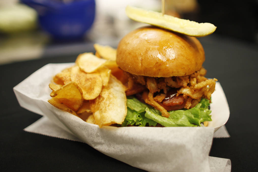 A new burger that will be sold during July under the new concessionaire, Centerplate, on Monday, April 10, 2017, at Cashman Field in Las Vegas. It has aged cheddar bacon sausage, chili, and chedda ...