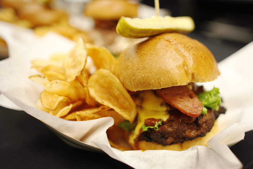The new April burger that will be sold under the new concessionaire, Centerplate, on Monday, April 10, 2017, at Cashman Field in Las Vegas. It has bacon brown sugar sausage, BBQ sauce, and America ...