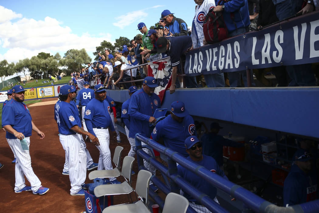 Chicago Cubs players and staff leave the field after defeating the Cincinnati Reds 11-7 in their Big League Weekend baseball game at Cashman Field in Las Vegas on Saturday, March 25, 2017. (Chase  ...