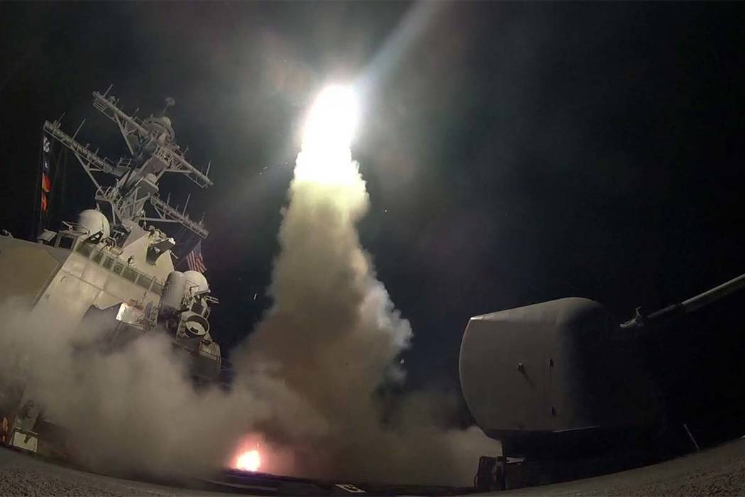 The guided-missile destroyer USS Porter launches a tomahawk land attack missile in the Mediterranean Sea, Friday, April 7, 2017. The U.S. blasted a Syrian air base with a barrage of cruise missile ...