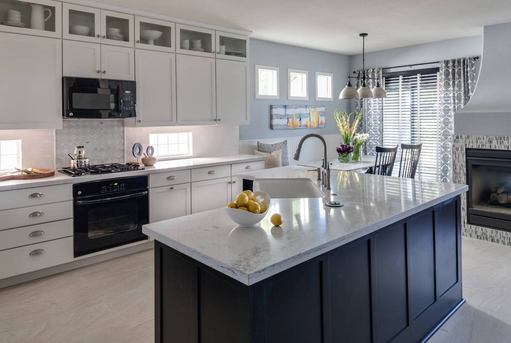 Lydia Cutter Photography Lisa Escobar Design used cup and cabinet pulls in a brushed satin nickel finish from Tob Knobs to add sophistication to the simple lines of the white shaker-style cabinetry.
