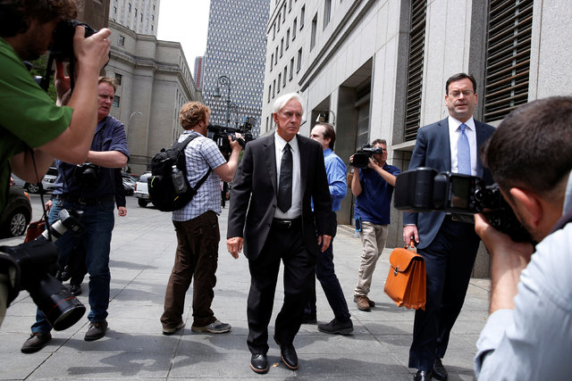 """Professional sports gambler William """"Bill"""" Walters, center, center, departs Federal Court with his lawyer Barry Berke after a hearing in New York City, June 1, 2016. (Lucas Jackson/Reuters)"""