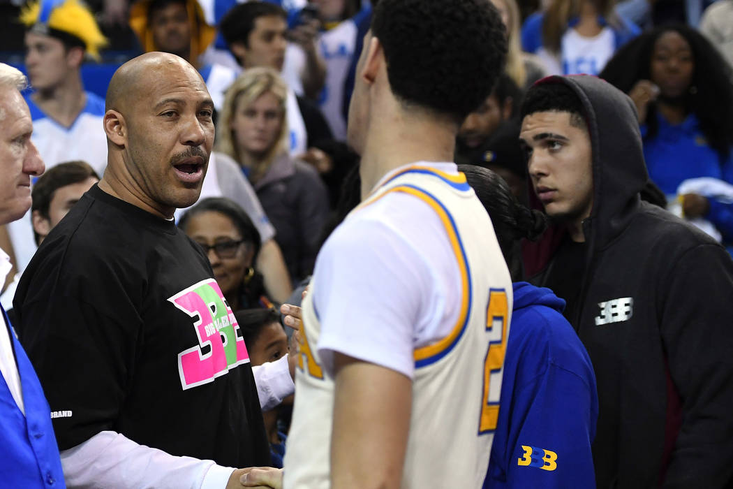 In this March 4, 2017, file photo, UCLA guard Lonzo Ball, right, shakes hands with his father LaVar following an NCAA college basketball game against Washington State in Los Angeles. UCLA won 77-6 ...